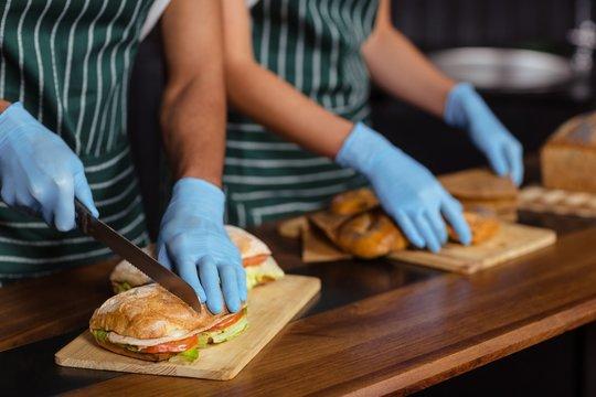 Close up of baristas preparing sandwiches