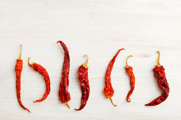 Seven dried red hot peppers