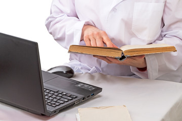 Doctor with book and laptop