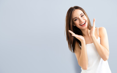 young woman showing smile, with copyspace
