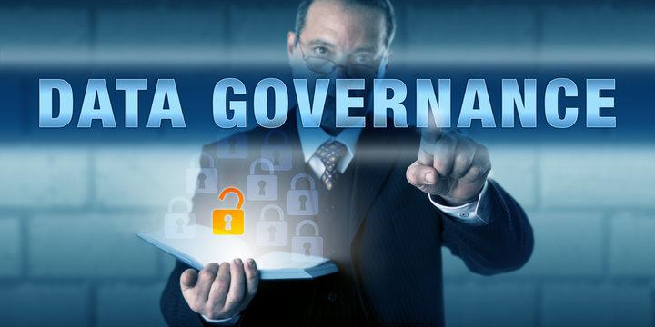 Businessman Pushing DATA GOVERNANCE