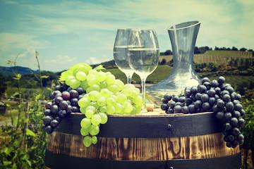 Fototapete - White wine bottle and wine glass on wodden barrel. Beautiful Tus