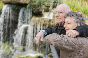 elderly couple and a waterfalls