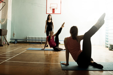 Caucasian dancers stretching in gym