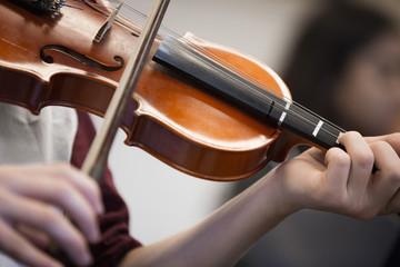 Caucasian student musician playing violin