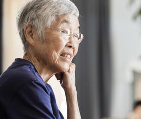 Older Asian woman smiling