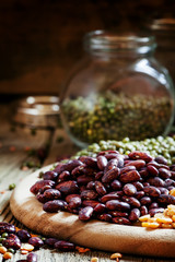Dry purple beans, bean mix on plate, Vintage wood background, se