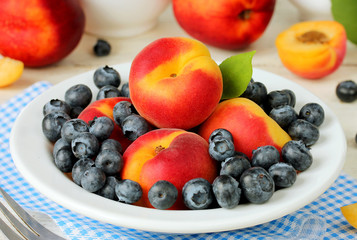 Bowl of healthy fresh fruit salad apricots and blueberries