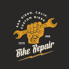 Bike Repair Abstract Vintage Vector Sign, Label or Logo Template. Fist Holding Wrench with Retro Typography and Shabby Textures.