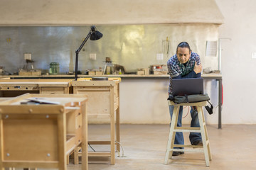 Native American artist using laptop in studio