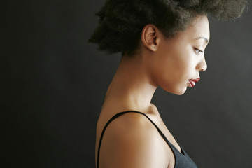Close up profile of black woman looking down