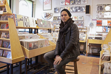 Portrait of a young man in a record store