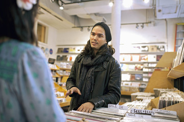 People talking in a record store