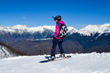 A girl on snowboard