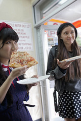 Friends hanging out eating pizza