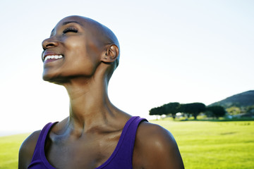 African American woman smiling in park