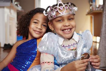 Smiling girls playing dress-up