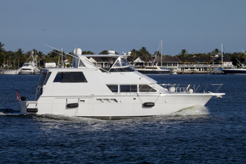 Luxury yatch in the intercoastal waterway with West Palm Beach, Florida in the background.
