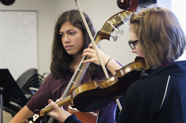 Students rehearsing in high school band class