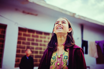 Girl looking up and laughing