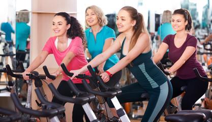 Females training on exercise bikes