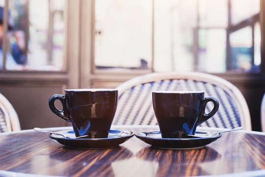 two cups of coffee on the table in cafe in Paris