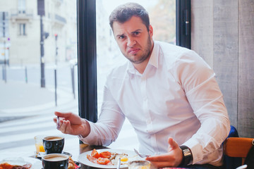 displeased angry customer in restaurant, man unhappy with food and bad service
