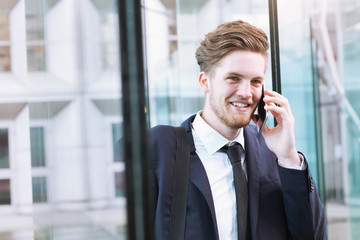 portrait of smiling businessman talking by phone
