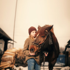 Caucasian girl holding rein of horse