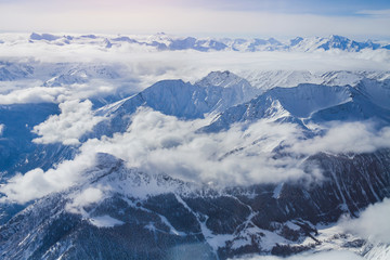 Alps, panoramic view of winter mountains with clouds above seen from Punta Helbronner