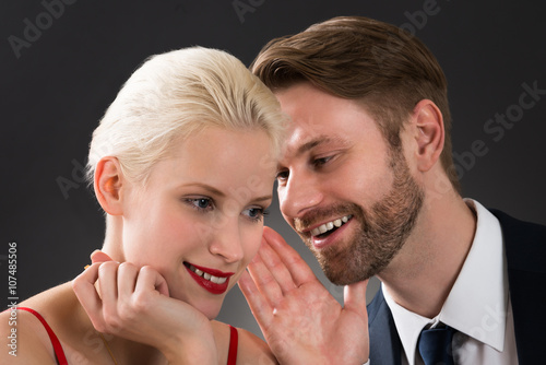 quotman whispering in womans earquot stock photo and royalty