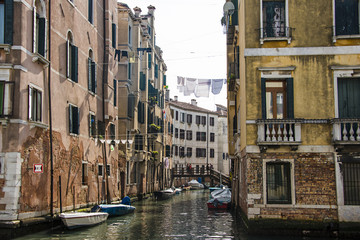 Clotheslines over canal between apartment buildings, Venice, Italy