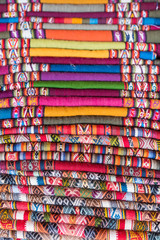 Colorful peruvian blanket for sale in the market as souvenir