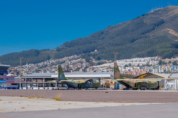 Two airplanes abandoned, this space used to be an airport. Behind a nice view of the city and a mountain