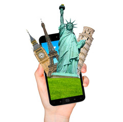 Famous monuments of the world going out of a mobile phone on whi
