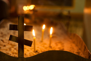 cross and candles in the church