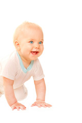 Smiling baby crawling and looking out.