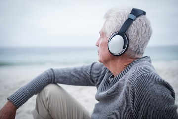 Senior man listening to music on headphone