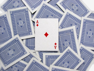 The ace of diamonds on a deck of playing cards