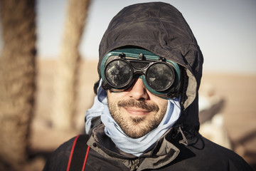 Portrait of male traveler wearing goggles