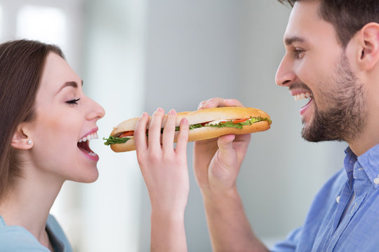 Couple Sharing Sandwich