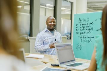 Businessman talking in office meeting
