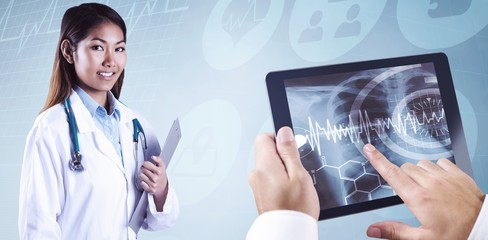 Composite image of asian doctor holding clipboard