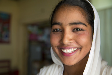Close up of smiling girl wearing headscarf