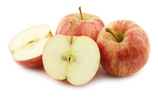 fresh sweet small apples and a cut one on a white background