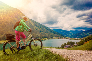 woman with e-bike above a lake-e-power 26