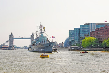 Belfast Ship and Tower Bridge over River Thames in London