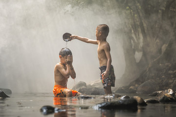 Children play in the river