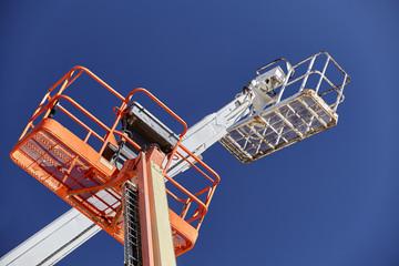 Construction Cranes aerial boom man lifts sky