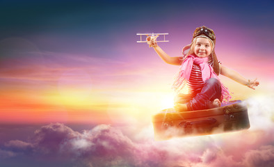 Fotobehang - Child Flying With Fantasy On Suitcase In The Sky